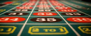 Casinos in England reopen; players not allowed to touch their cards